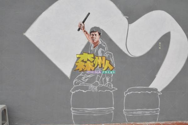 二十四节令鼓壁画的鼓手,是否貌似香港武打明星甄子丹呢?