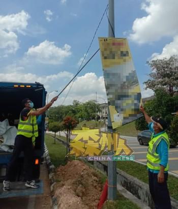 市政局工作人员拆除逾期张挂的横幅费用甚大,并呼吁商家须自行拆除横幅,以免遭罚款。